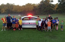 "Gainesville Police Department Officers Join Hidden Oak's Morning Milers with ""Cops for a Cure"" Patrol Car"